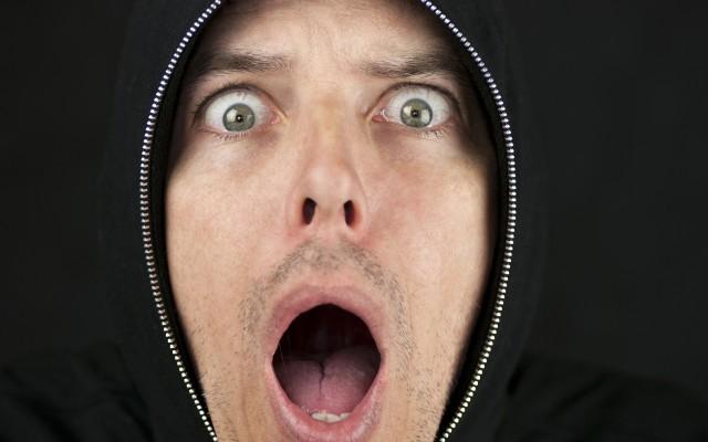 Shocked Man Looks To Camera